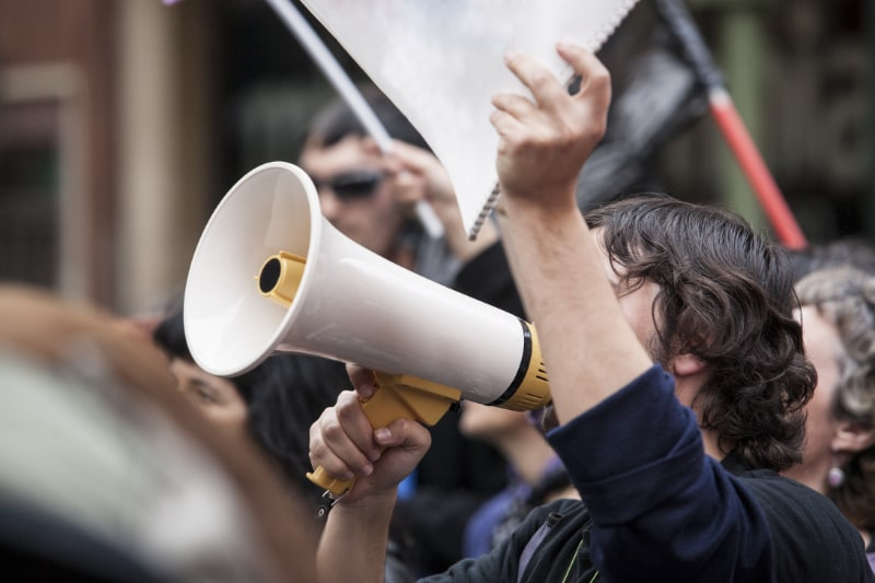 man with megaphone during protest rally